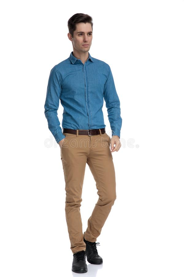 Smart casual man wearing blue shirt and looking to side stock photography