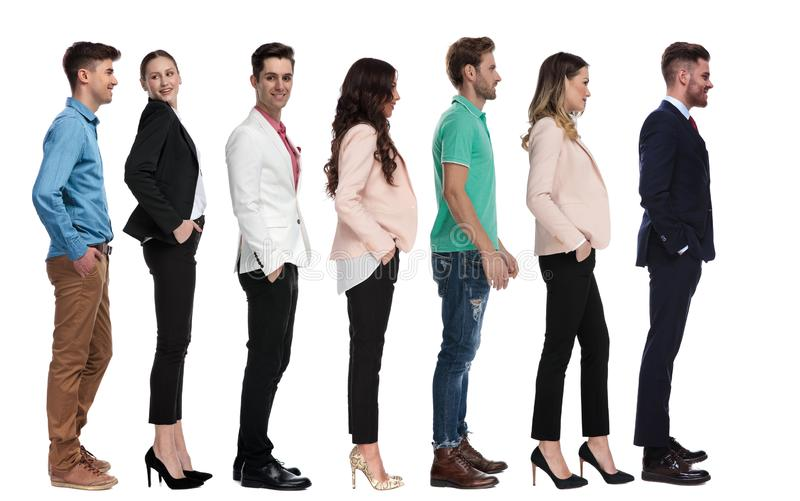 Smart casual people waiting in line stock photography