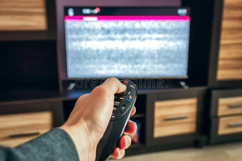Smart channel switch remote and intelligent TV controls royalty free stock photo