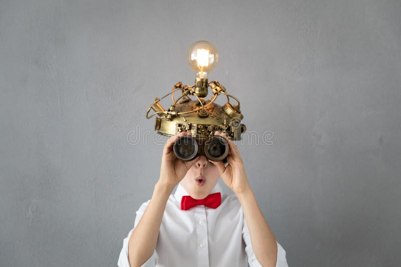 Education, start up and business idea concept. Smart child pretend to be businessmen. Funny kid playing at home. Education, start up and business idea concept royalty free stock image