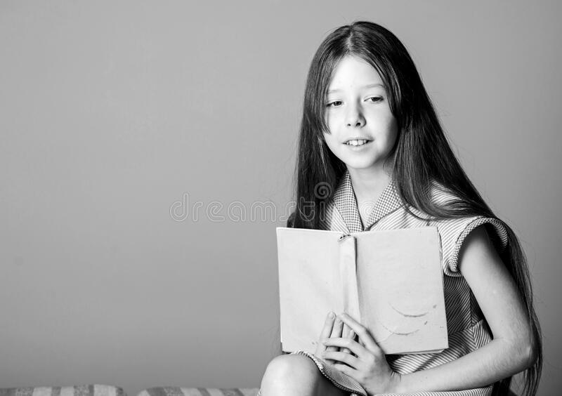 Smart. childrens literature. book lover. small girl read interesting story. fiction book. home education. Happy. Childhood. keep her secrets in diary. book royalty free stock photos
