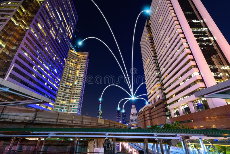 Smart city and internet line in blue tone, wireless communication network line on city commercial building background.  royalty free stock photography