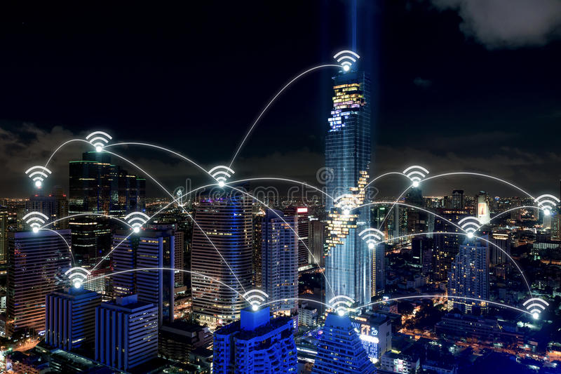 Smart city and wireless communication network, business district. With office building, abstract image visual, internet of things concept royalty free stock photo