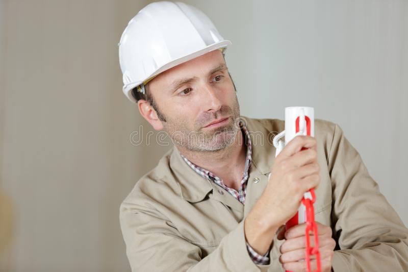 Smart concentrated builder in construction site stock photography