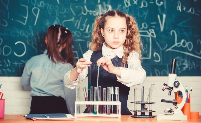 Smart and confident children. Chemistry lesson. students doing biology experiments with microscope in lab. Little kids stock image