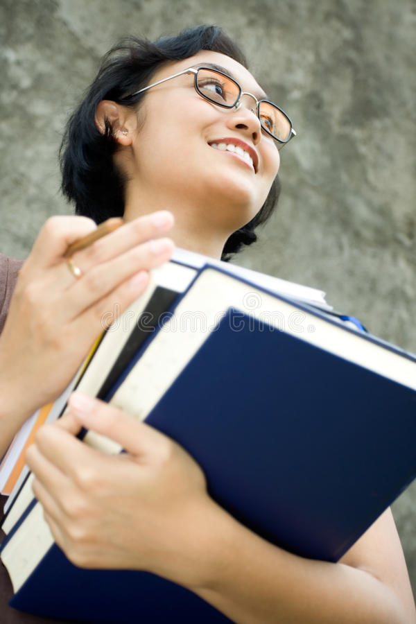 Smart and confident female college student stock photo