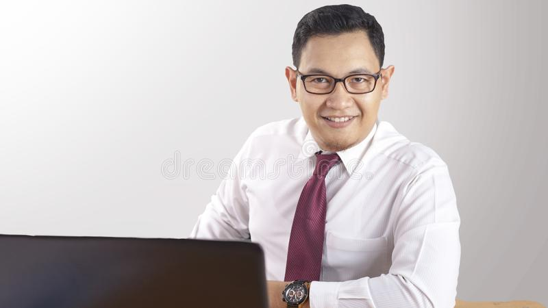 Smart Confident Successful Businessman Smiling Happily. Portrait of smart confident successful Asian businessman smiling happily, male worker employee royalty free stock images