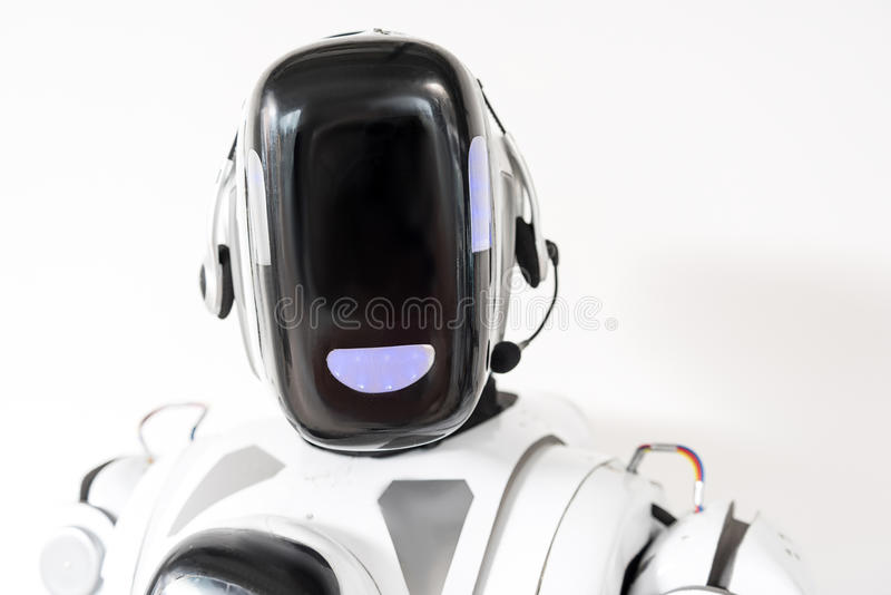 Smart cyborg is wearing earphones with microphone stock image