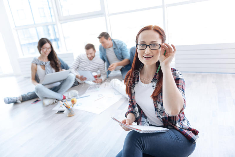 Smart delighted woman being a team leader stock images