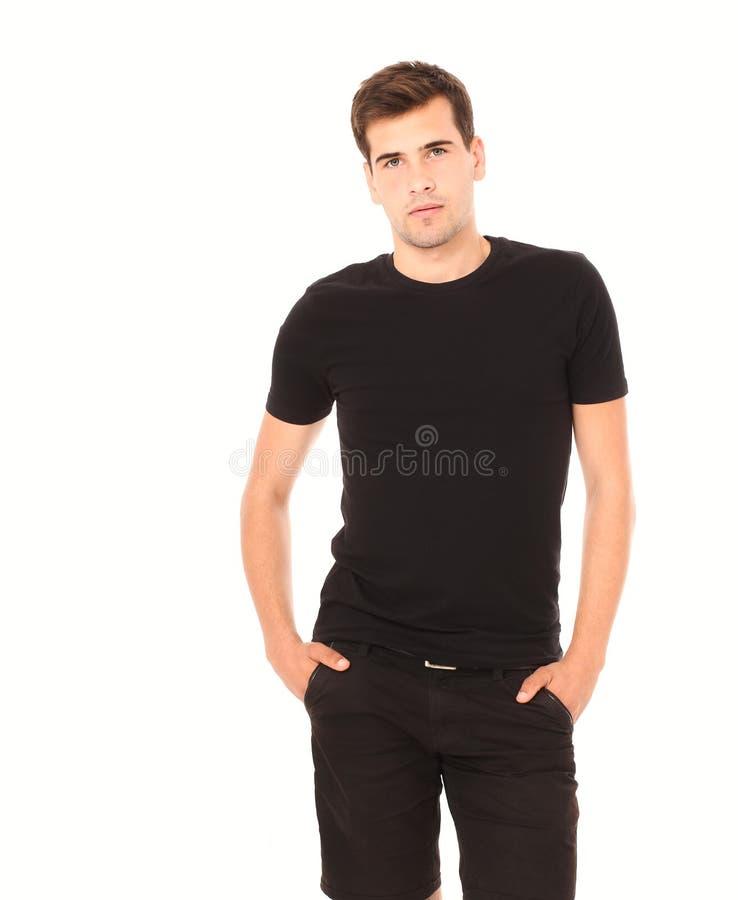 Smart die de jonge mens in zwart leeg die malplaatjeoverhemd denken op wit wordt geïsoleerd De ruimte van het exemplaar Front Vie royalty-vrije stock foto