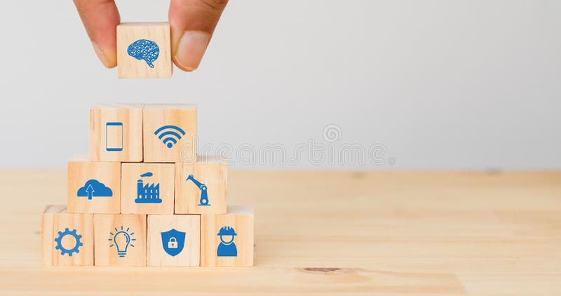 Smart factory, industry 4.0 futuristic technology trend concept, Hand man put the icon to connect, icons including wifi, ai ,artif. Icial intelligence, phone royalty free stock photo