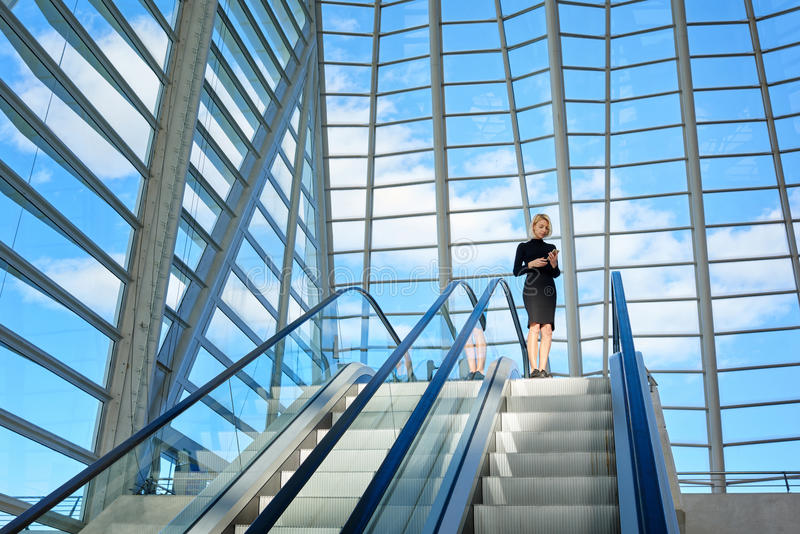 Smart female managing director of successful company is booking o-nline car for business trip stock photography