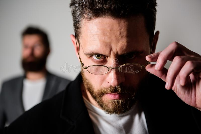 Smart glance. Accessory for smart appearance. Now i see everything. Attentive glance. Picky smart inspector. Man. Handsome bearded guy wear eyeglasses. Eye stock image