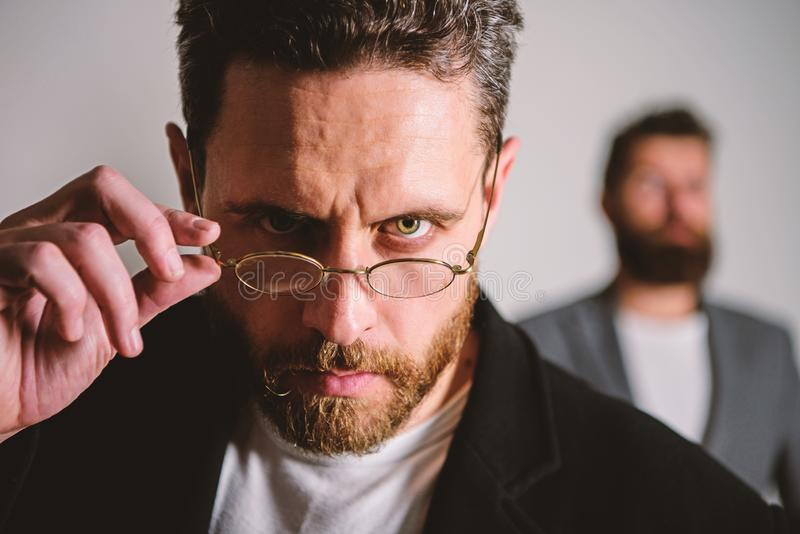 Smart glance. Accessory for smart appearance. Now i see everything. Attentive glance. Picky smart inspector. Man. Handsome bearded guy wear eyeglasses. Eye royalty free stock image