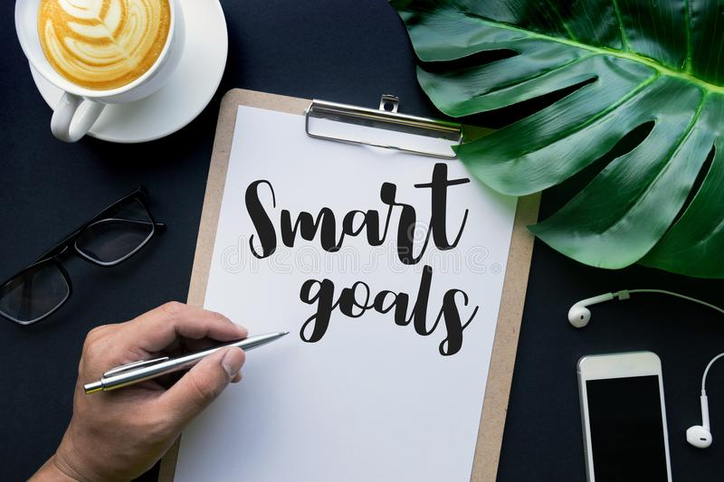 Smart goals text with hand writing on notepaper and accessories royalty free stock photos