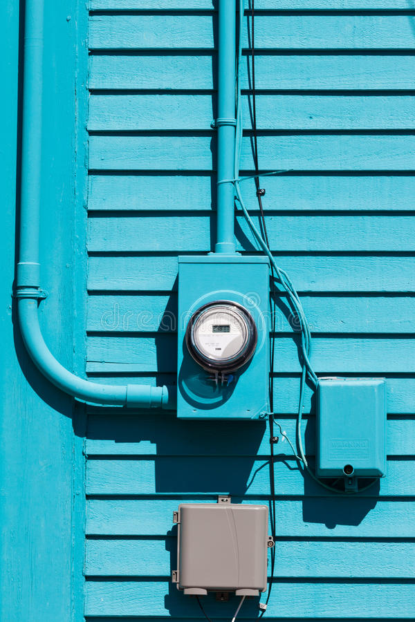 Smart grid electric meter connection on blue wall royalty free stock photography
