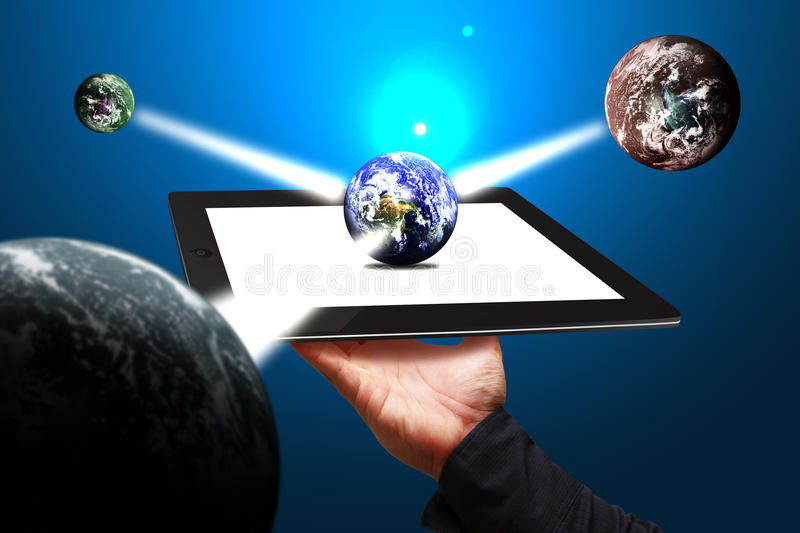 Smart hand show world connected on tablet computer royalty free stock photo