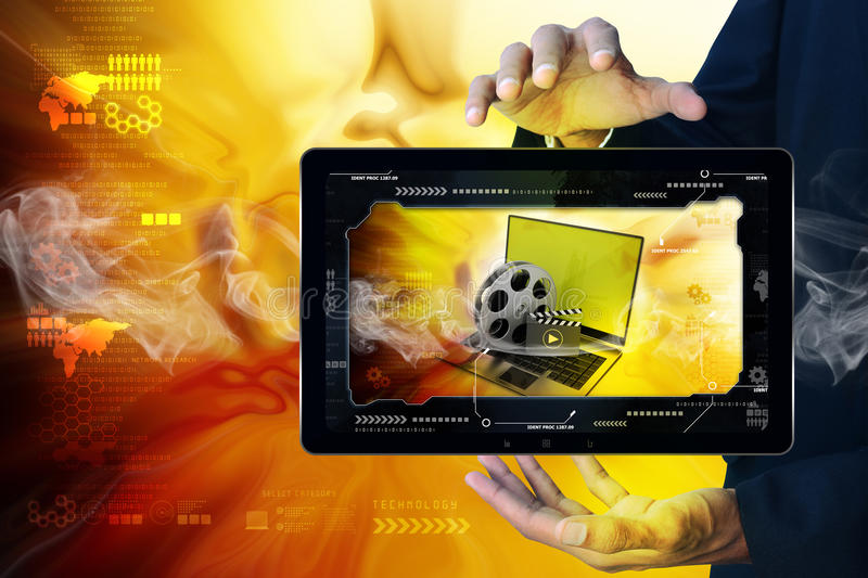 Smart hand showing Laptop with reel in frame. In color background royalty free stock photos