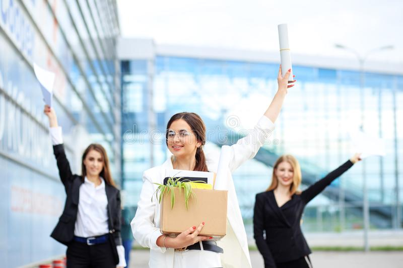 A smart happy woman was taken to work in a corporation. Concept for business, boss, robot, team and success stock images