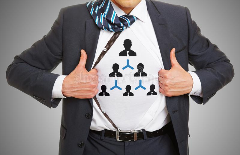 Smart Hierarchy concept with symbol under suit. Smart Hierarchy concept with man wearing the symbol on t-shirt under his shirt royalty free stock photography