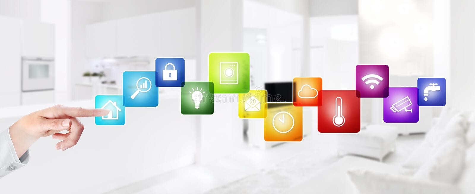 Smart home automation hand touch screen with colored symbols on interior rooms blurred background web banner and copy space. Smart home automation hand screen stock photo