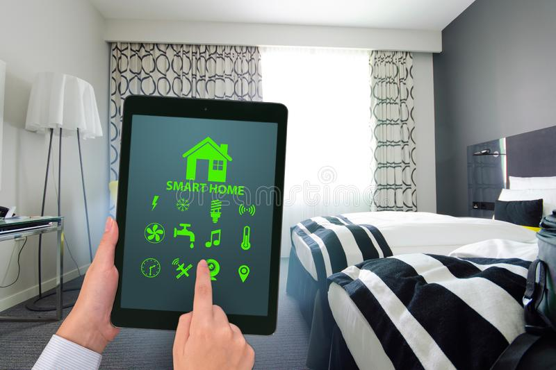 Smart home concept with devices and appliances. The smart home concept with devices and appliances royalty free stock image