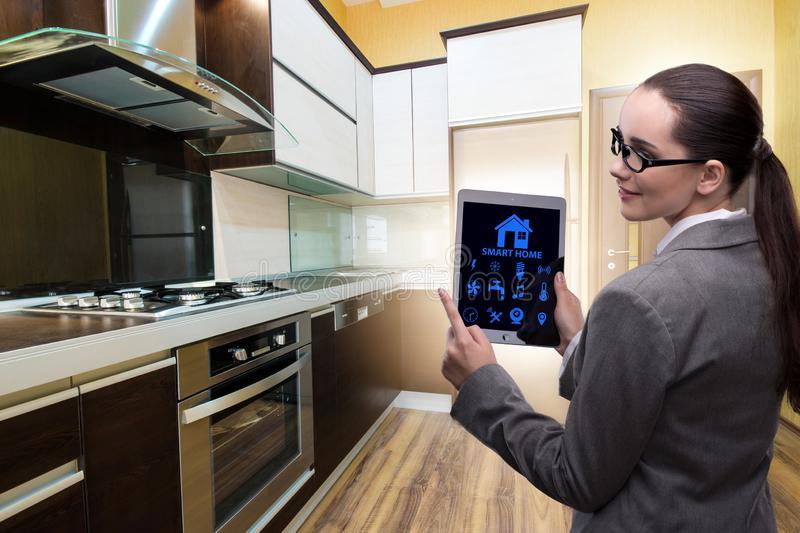 The smart home concept with woman stock photography