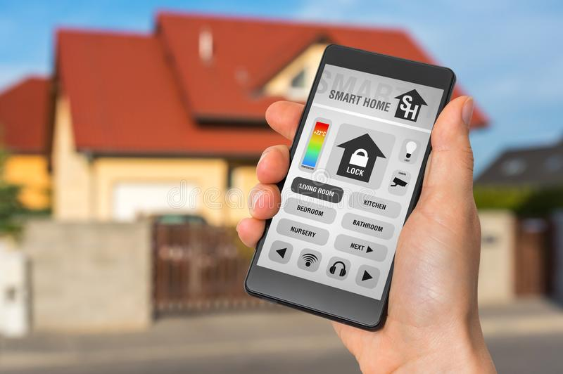 Smart home control app on smartphone - smart home concept stock photography