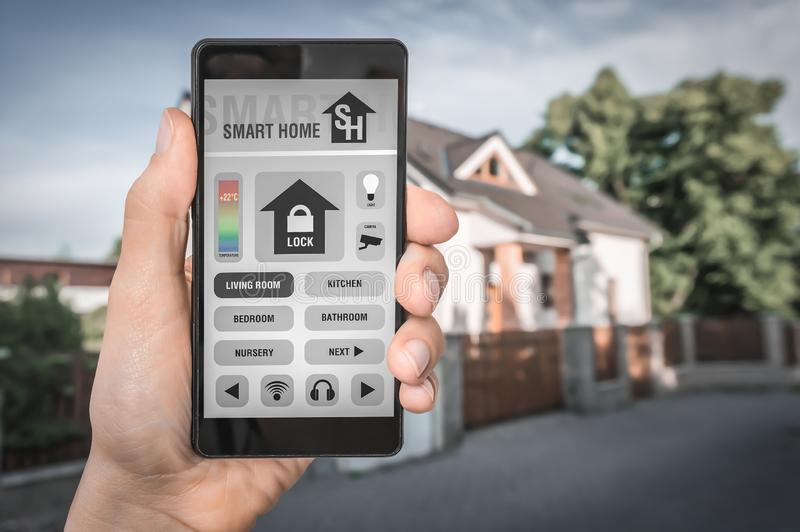 Smart home control app on smartphone - smart home concept royalty free stock image