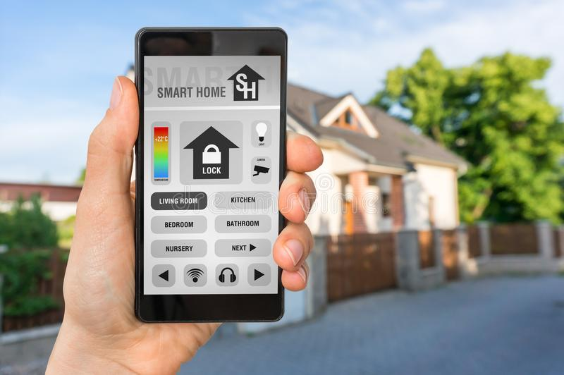 Smart home control app on smartphone - smart home concept royalty free stock photo