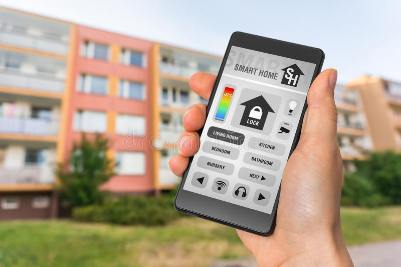 Smart home control app on smartphone - smart home concept stock photo