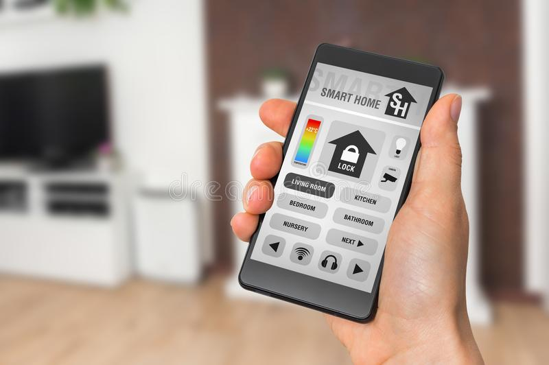 Smart home control app on smartphone - smart home concept stock images