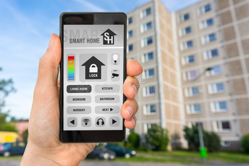 Smart home control app on smartphone - smart home concept royalty free stock photos