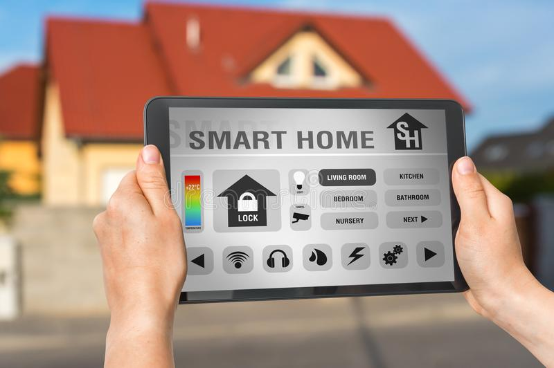 Smart home control app on tablet - smart home concept stock photography