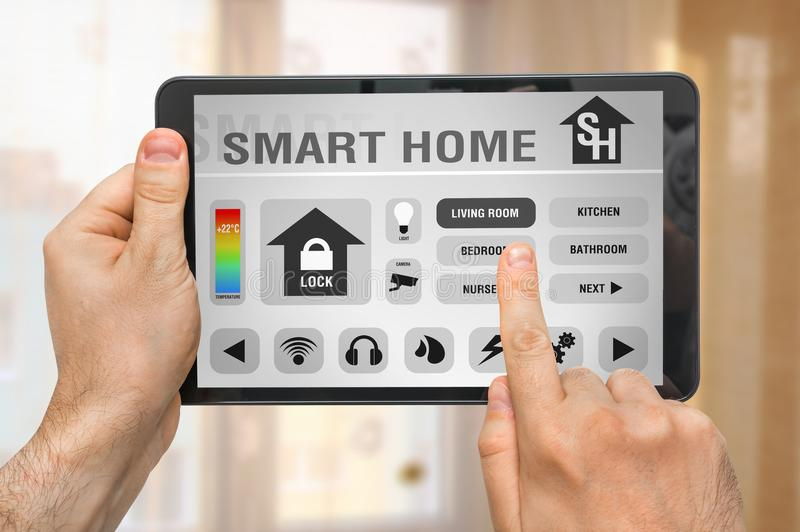 Smart home control app on tablet - smart home concept stock photos