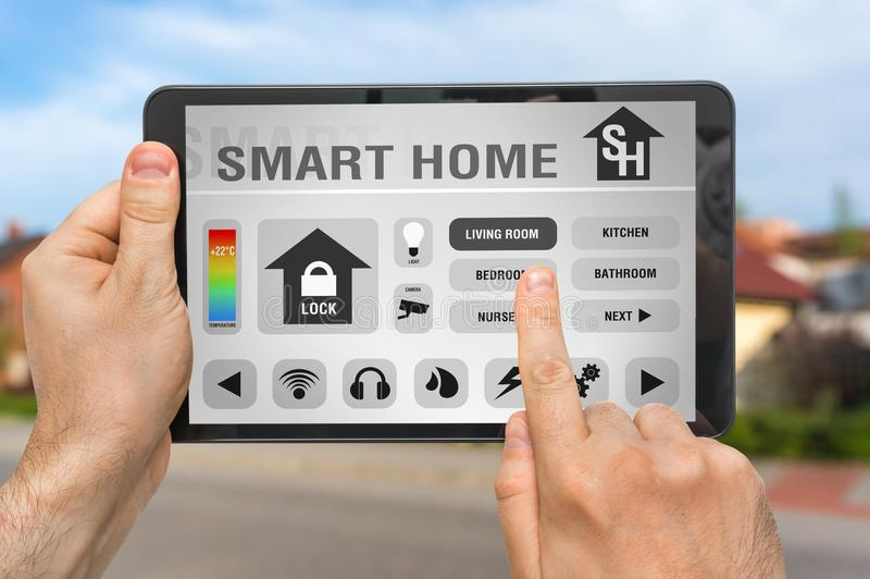 Smart home control app on tablet - smart home concept royalty free stock photography
