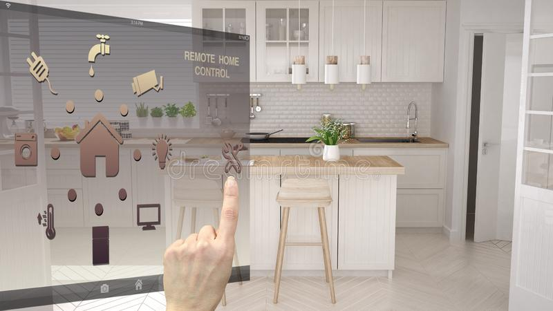 Smart home control concept, hand controlling digital interface from mobile app. Blurred background showing modern white modern. Scandinavian kitchen royalty free stock photography