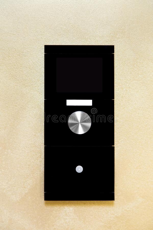 Smart home control controller with a screen and buttons to control. Smart home control controller with a screen and buttons to control the light and temperature royalty free stock photo