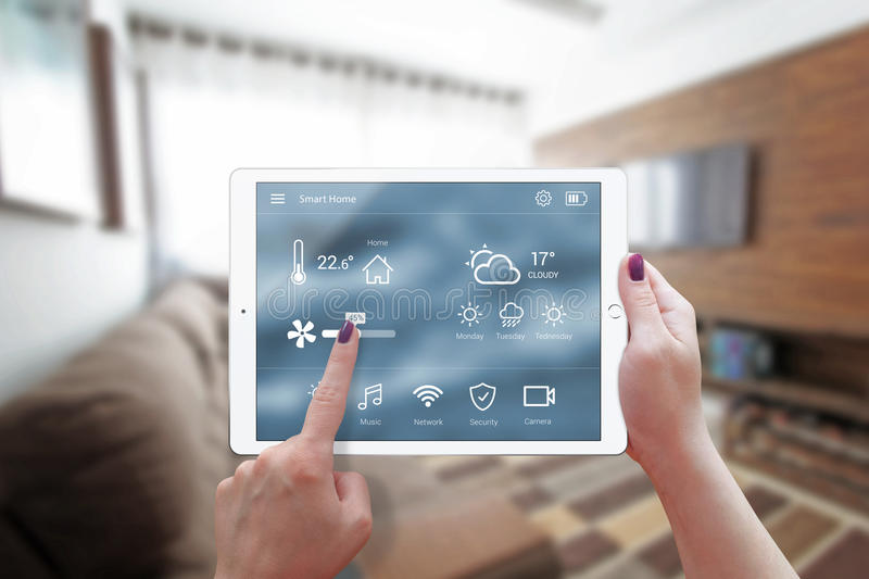 Smart home control on tablet. stock photo