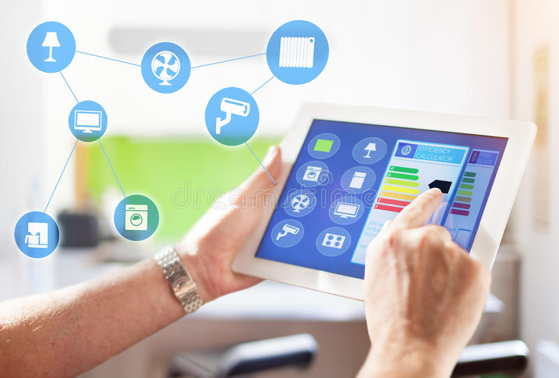 Smart Home Device - House automation home Control concept. Smart home, intelligent house automation remote control technology concept on smart phone / tablet royalty free stock photos
