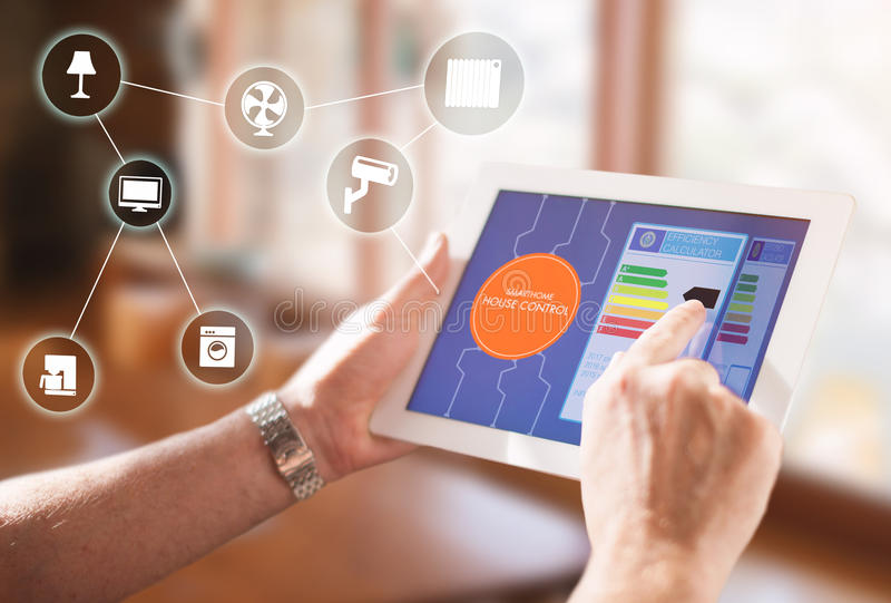 Smart Home Device - House automation home Control concept. Smart home, intelligent house automation remote control technology concept on smart phone / tablet royalty free stock images