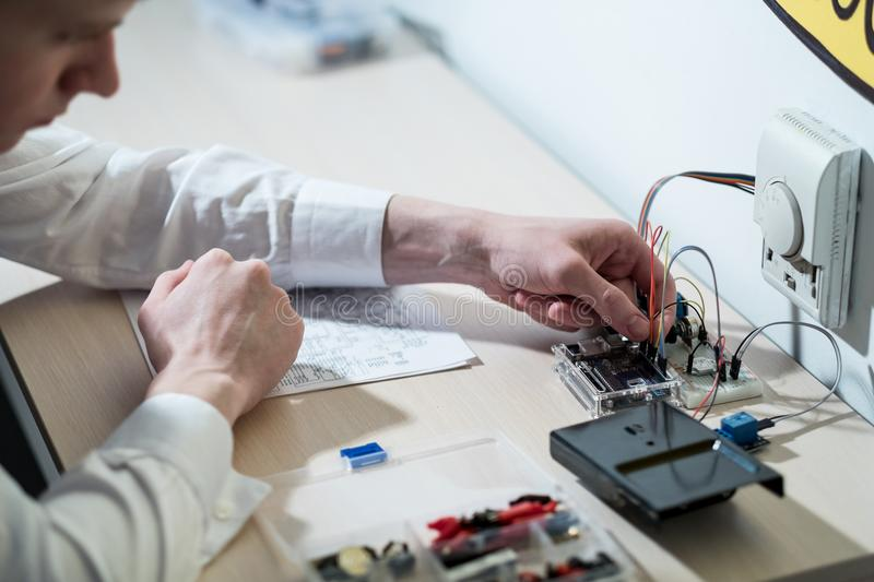 Smart home system assemble electronic component. Smart home system. technology development for efficient use of resources. engineer assembling electronic royalty free stock photography