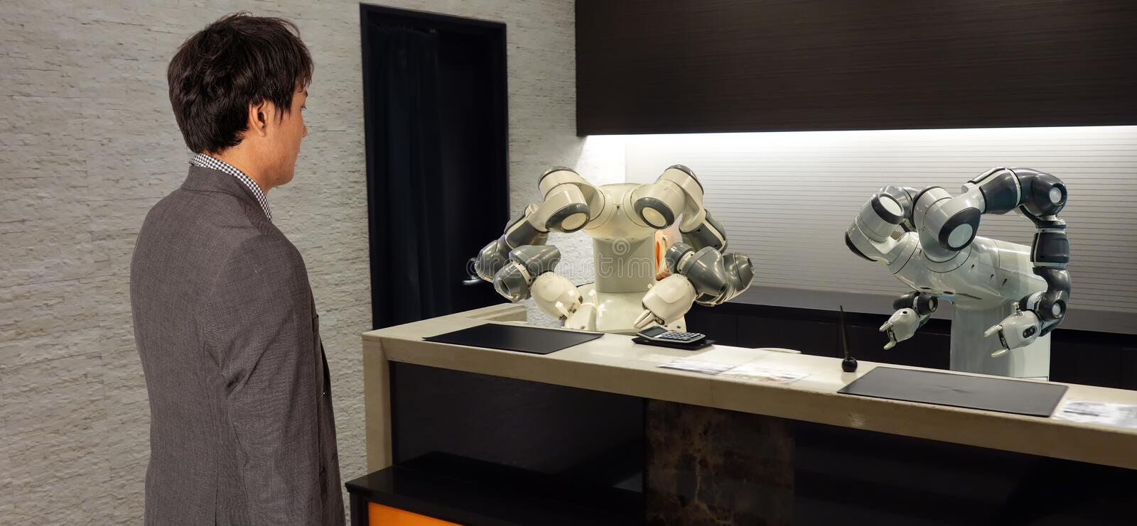 Smart hotel in hospitality industry 4.0 concept, the receptionist robot robot assistant in lobby of hotel or airports always w royalty free stock photo
