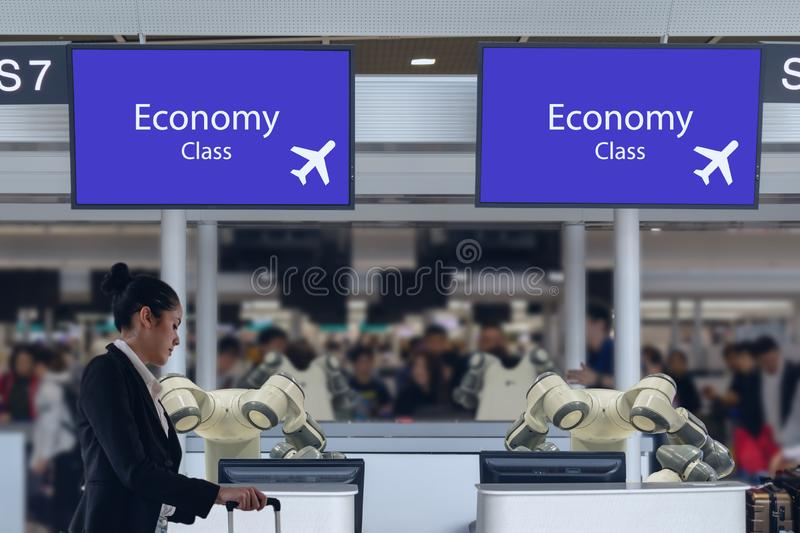 Smart hotel in hospitality industry 4.0 concept, the receptionist robot robot assistant in counter check in airports always welcom royalty free stock image