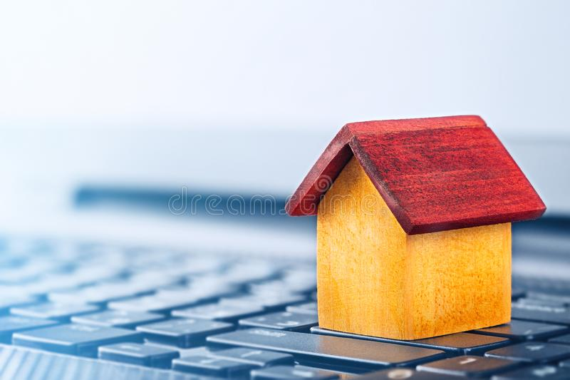 Smart house concept, house on laptop keyboard. Idea for smart house, eco technology and computer monitoring, modern technology, IT. And real estate.concept of stock photos