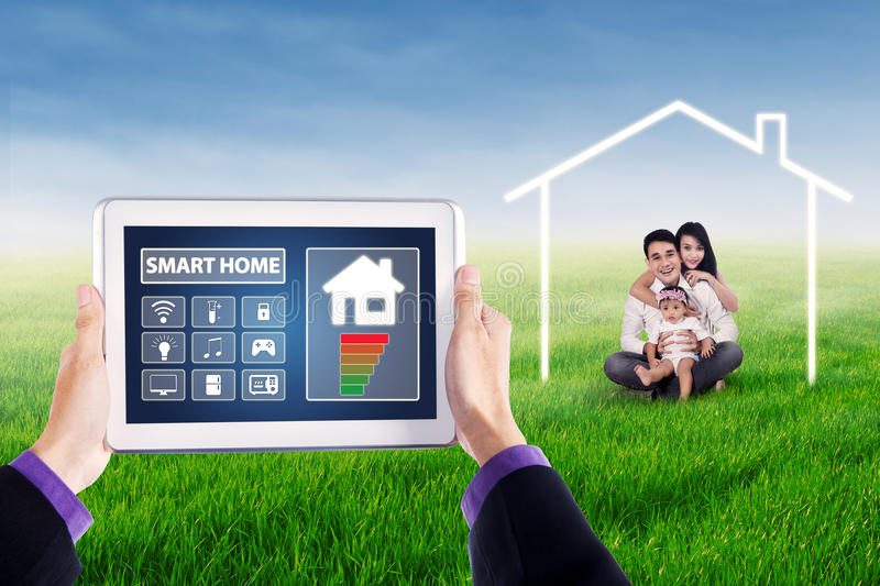 Smart house controller icons and Asian family royalty free stock image