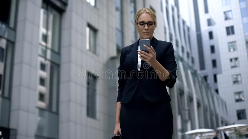 Smart lady extremely happy to win money on online betting, using smartphone. Stock photo royalty free stock photo