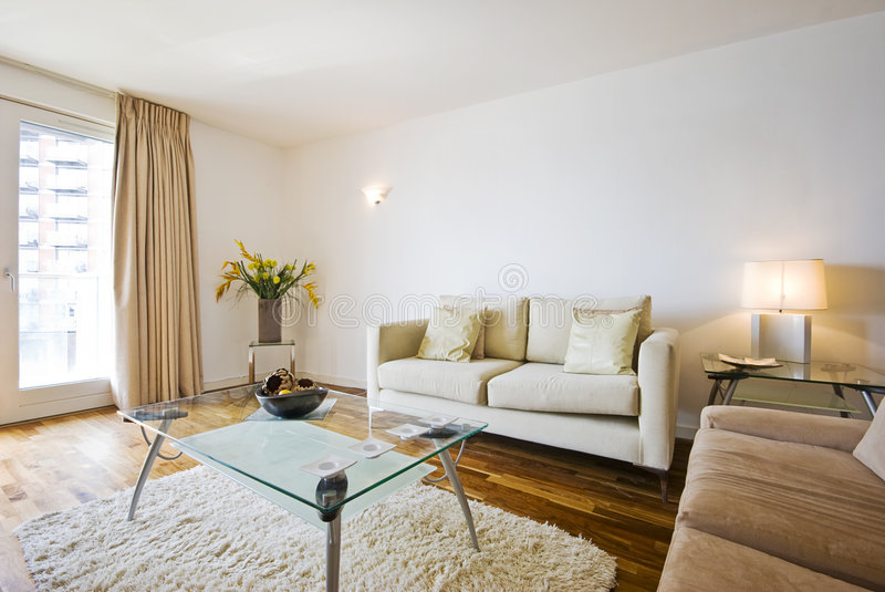 Smart living room. With modern furniture and balcony access royalty free stock image