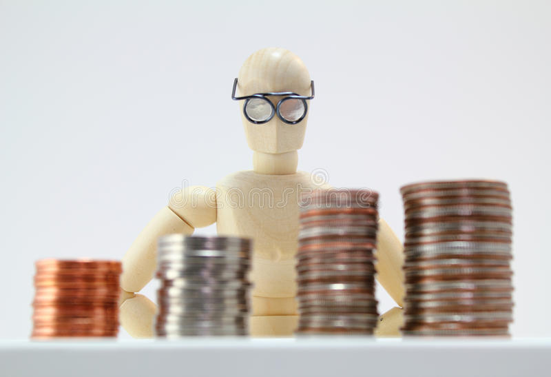 Smart Looking Character Looking At US Coins. Stock Photos