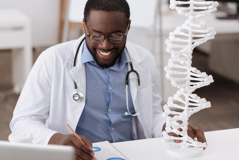 Smart male scientist studying genetics stock photos